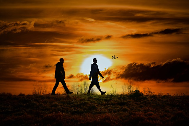 people walking with a sunset in background